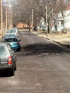 A narrow, one-way residential street serves as one of the few northern exits from downtown.